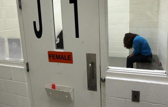 A woman being held at an ICE detention facility. Photo: Getty Images/John Moore